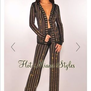 Pant suit with rhinestones.